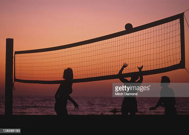sunset beach volleyball - beach volleyball stock pictures, royalty-free photos & images