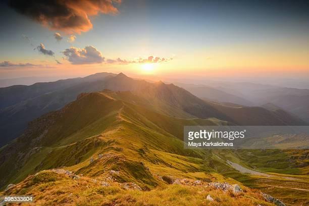 Sunset behind a mountainious ridge