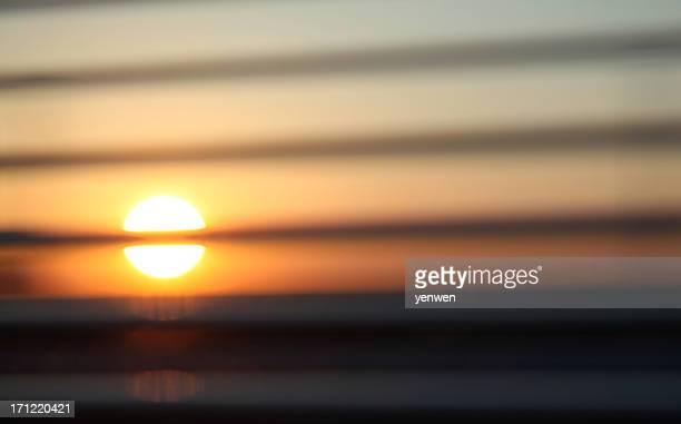 Sunset behind Blinds