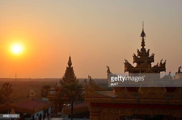 Sunset behind buddhist pagoda in Mumbai