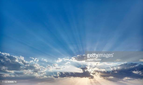 sunset behind clouds - back lit stock pictures, royalty-free photos & images