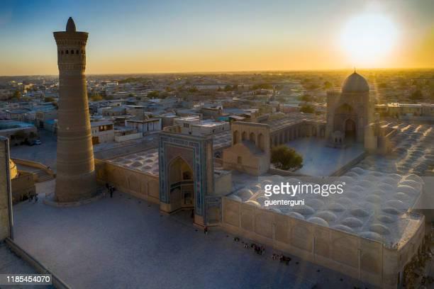 sunset behind kaylan minaret, bukhara, historic silk road, uzbekistan - ancient civilization stock pictures, royalty-free photos & images