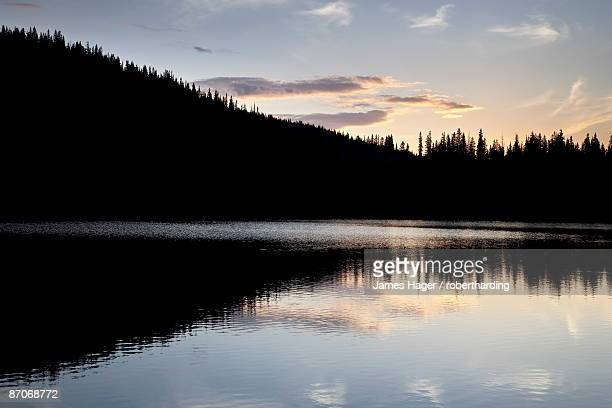 Sunset behind Mirror Lake, Gunnison National Forest, Colorado, United States of America, North America