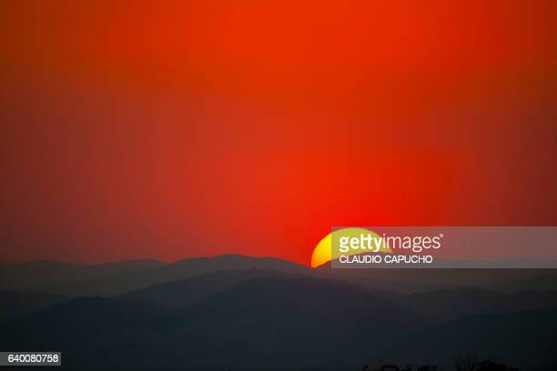 sunset behind mountains - claudio capucho stock photos and pictures