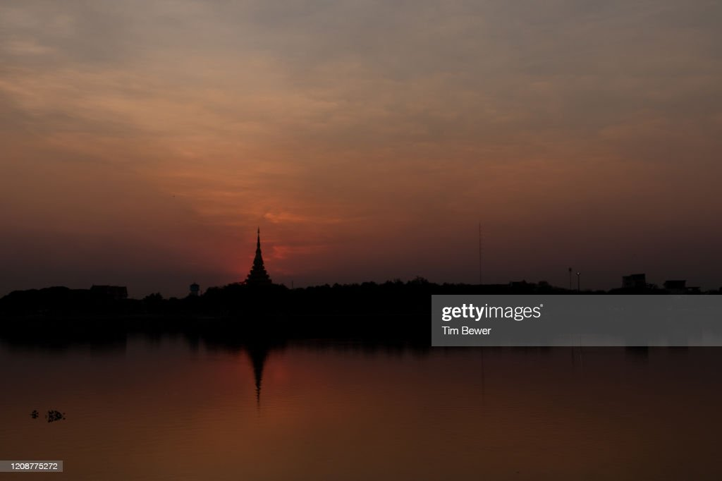Sunset behind Phra Mahathat Kaen Nakhon stupa. : Stock Photo