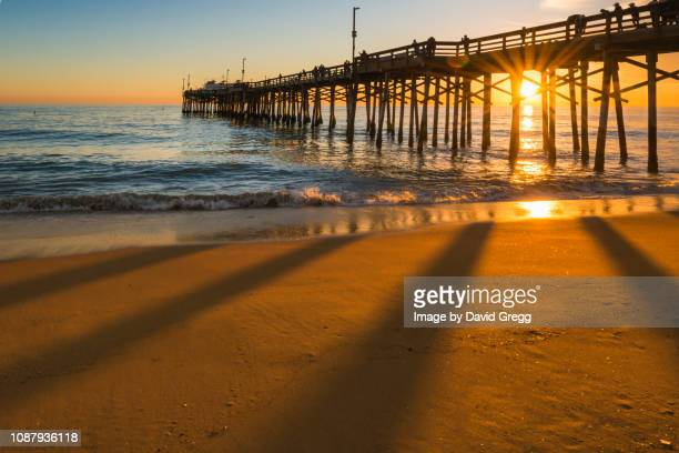 sunset behind the pier 1 - newport beach stock pictures, royalty-free photos & images