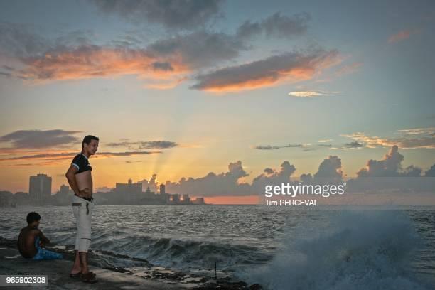 Sunset behind the surf watchers Malecon Havana