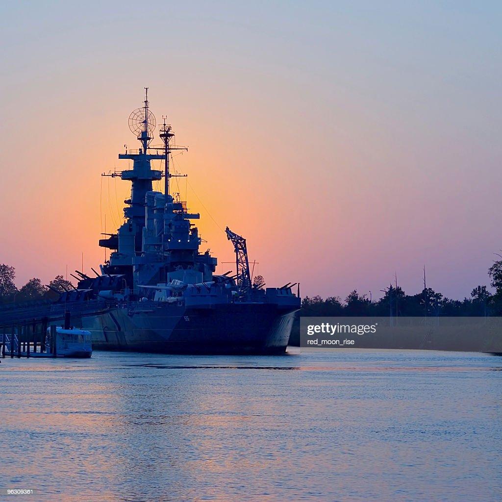 Sunset behind USS North Carolina : Stock Photo