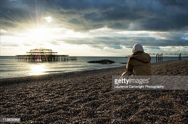 sunset behind west pier - hove stock pictures, royalty-free photos & images