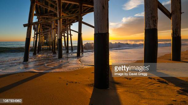 sunset beneath the pier - newport beach stock pictures, royalty-free photos & images