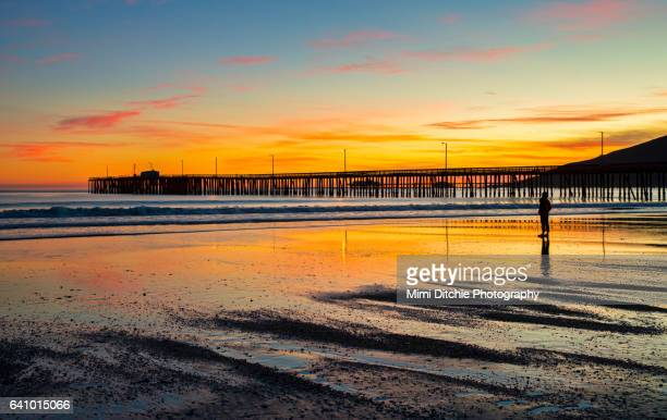 sunset beyond the pier - low tide stock pictures, royalty-free photos & images