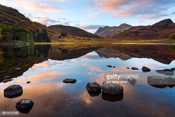 sunset, blea tarn, great langdale, lake district, cumbria, england - ambleside stock photos and pictures