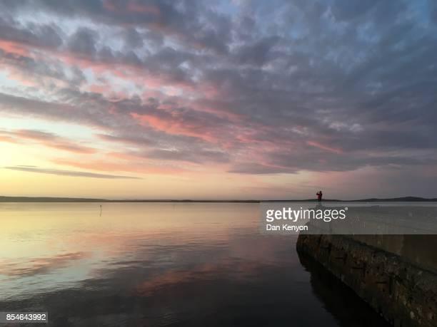 Sunset. Bowmore. Islay. Scotland. Man taking photo of sunset