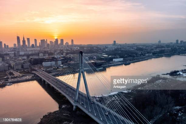 sunset, bridge, city, river - warsaw stock pictures, royalty-free photos & images