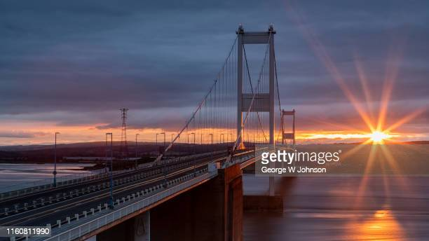 sunset bridge - severn river stock pictures, royalty-free photos & images