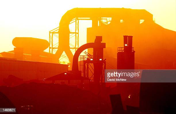 Sunset brings on the night shift at the roundtheclock operated TAMCO steel mini mill on October 4 2002 in Rancho Cucamonga California TAMCO...