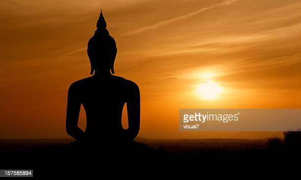 sunset buddha - buddha stock photos and pictures