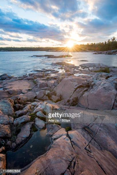 sunset by georgian bay - liu he stock pictures, royalty-free photos & images