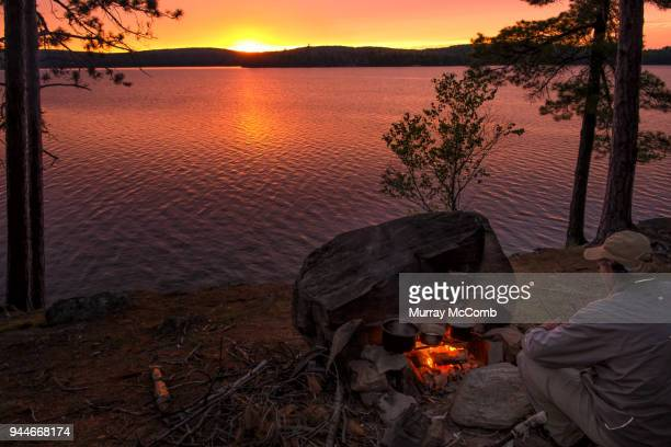 sunset campfire dinner - murray mccomb stock pictures, royalty-free photos & images