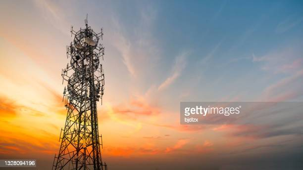 5g sunset cell tower: cellular communications tower for mobile phone and video data transmission - tower stock pictures, royalty-free photos & images