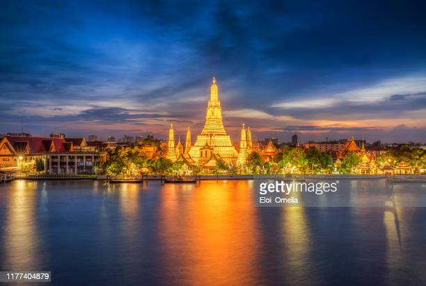 sunset city skyline at wat arun temple and chao phraya river, bangkok. thailand, - thailand stock pictures, royalty-free photos & images