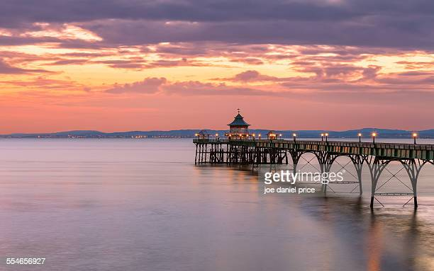 sunset, clevedon pier - clevedon pier stock pictures, royalty-free photos & images