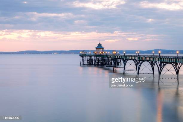 sunset, clevedon pier, somerset, england - clevedon pier stock pictures, royalty-free photos & images