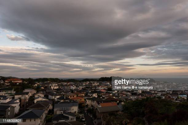 Sunset clouds on residential district by the sea in Japan