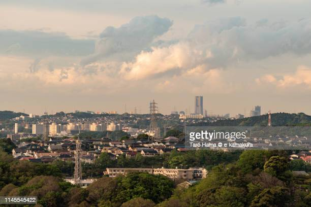 Sunset clouds on residential district on hill and city buildings in Japan