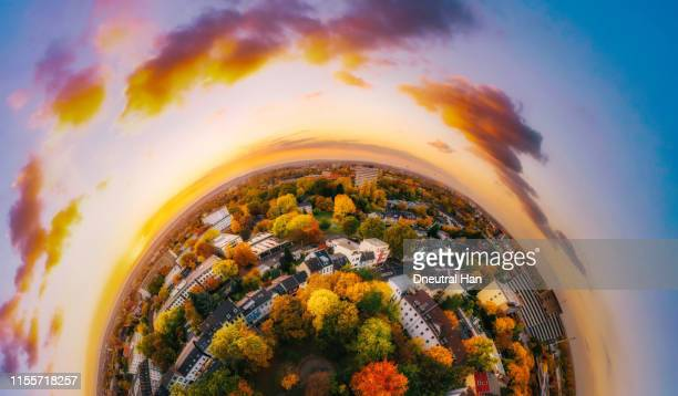 sunset clouds over bonn in autumn - little planet format stock photos and pictures