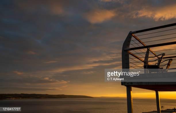 sunset coastal balcony - dusk stock pictures, royalty-free photos & images