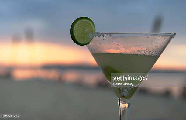 sunset cocktail at the beach on gili air, lombok - margarita beach stock photos and pictures