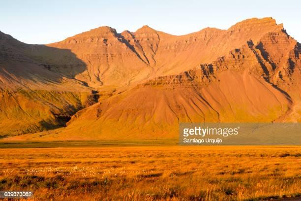sunset colouring mountains in orange - colouring bildbanksfoton och bilder
