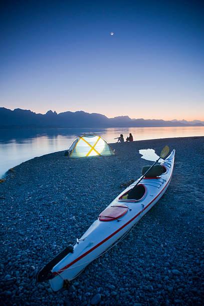 sunset, couple beach camping with kayak
