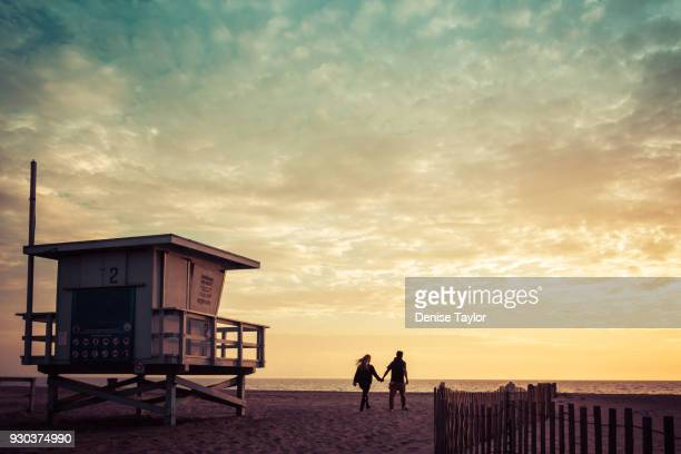 sunset couple - santa monica stock pictures, royalty-free photos & images