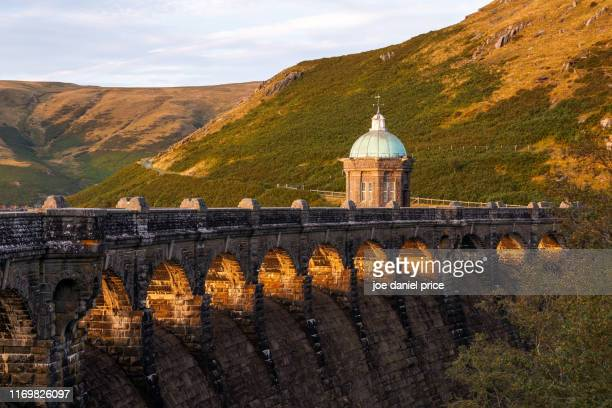 sunset, craig goch dam, rhayader dams, rhayader, elan valley, wales - goch stock photos and pictures