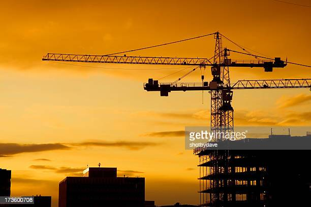 sunset cranes - crane construction machinery stock pictures, royalty-free photos & images