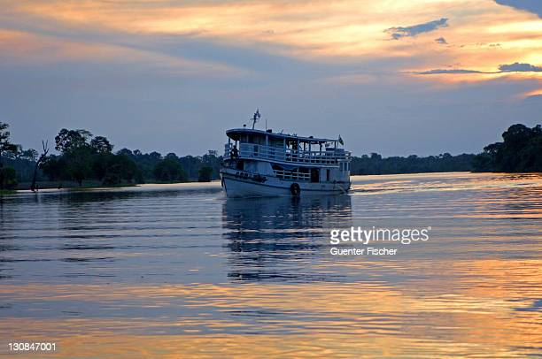 Sunset cruise on the Amazon river Brazil