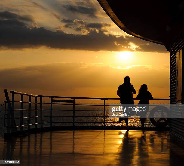 sunset cruise - deck stock pictures, royalty-free photos & images