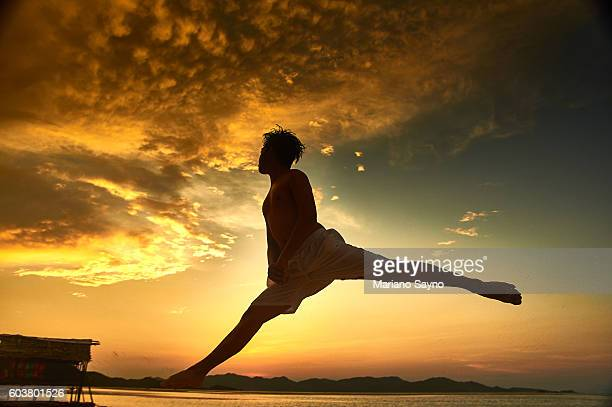 Sunset dance on the beach, Philippines, Asia