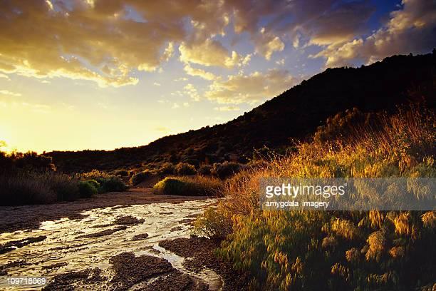 sunset desert mountain landscape stream and sky