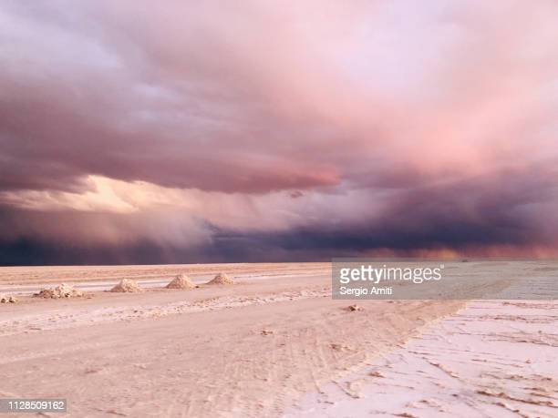 Sunset dramatic cloudy sky at Uyuni Salt Flats