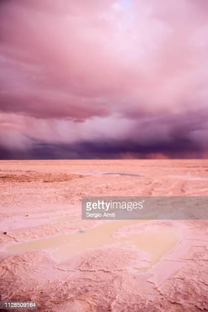 Sunset dramatic cloudy sky at Uyuni Salt Flats