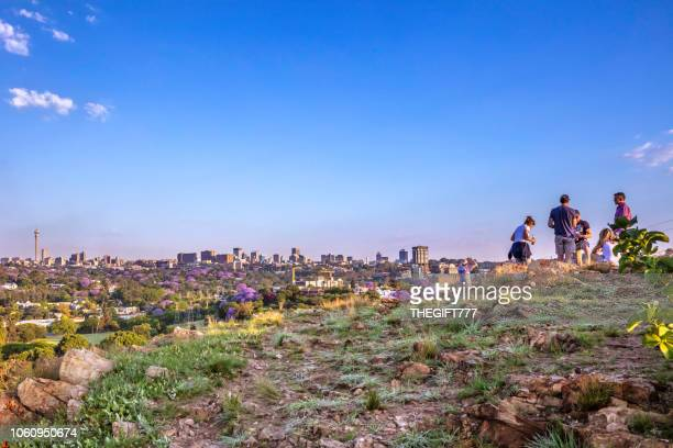 Sunset drinks on the hill overlooking Johannesburg cityscape