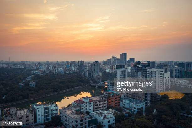 sunset drone photo of the cityscape of dhaka, bangladesh - bangladesh stock pictures, royalty-free photos & images