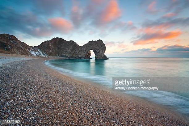 sunset, durdle door - bournemouth england stock pictures, royalty-free photos & images