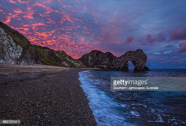sunset durdle dor - arch stock pictures, royalty-free photos & images