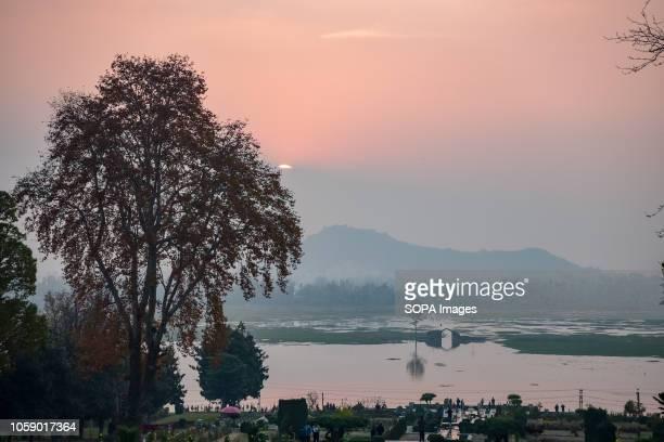 SRINAGAR JAMMU KASHMIR INDIA Sunset during autumn season in Srinagar Kashmir has been divided between India and Pakistan since their partition and...