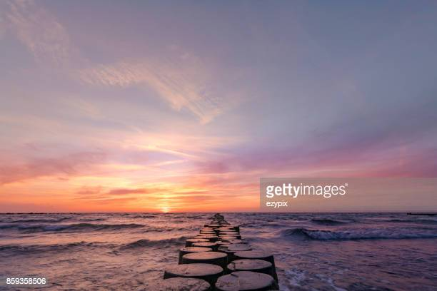 sunset east baltic sea - dusk stock pictures, royalty-free photos & images