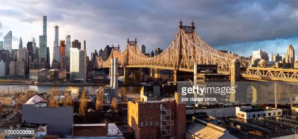 sunset, ed koch queensboro bridge, new york city, new york, america - ニューヨーク市クイーンズ区 ストックフォトと画像